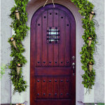 Wooden Front Door With Green Garland Gold