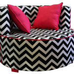 Elegant Zebra Saucer Chair Design with Red Cushions